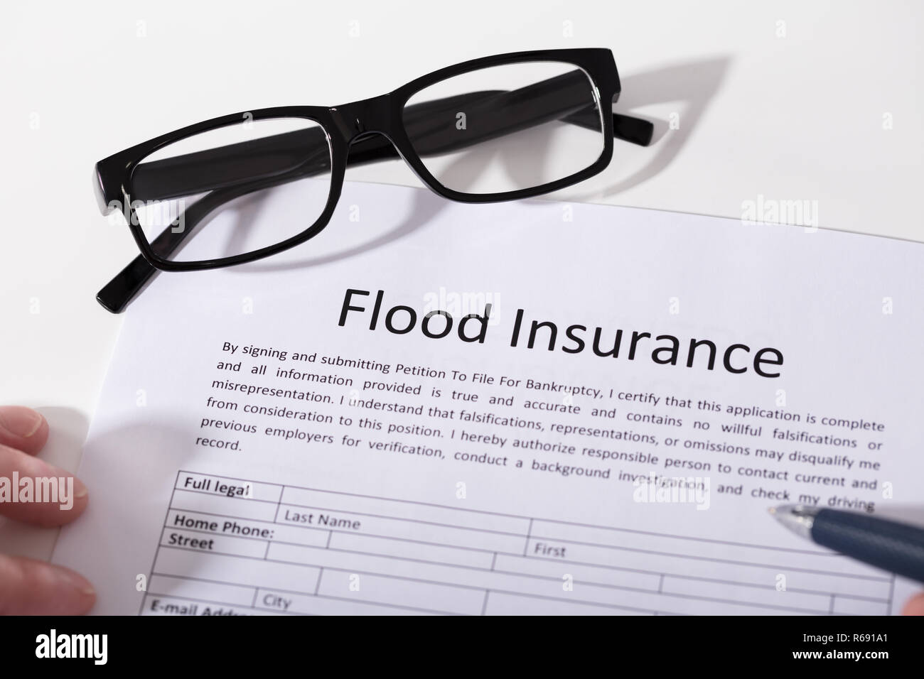 Elevated View Of Flood Insurance Form - Stock Image