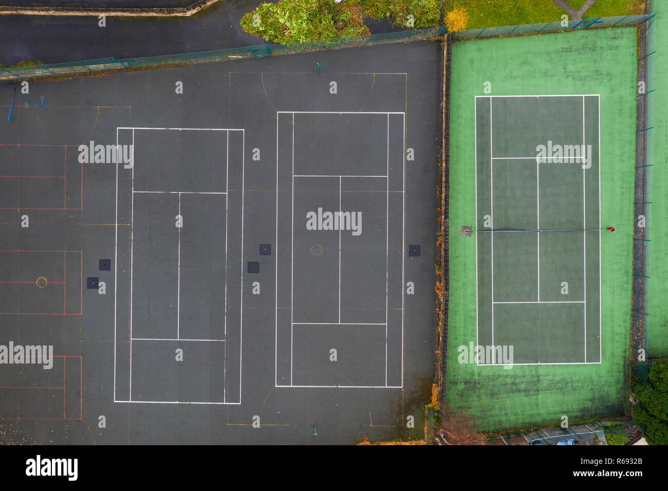 aerial overhead view of a row of green tennis courts