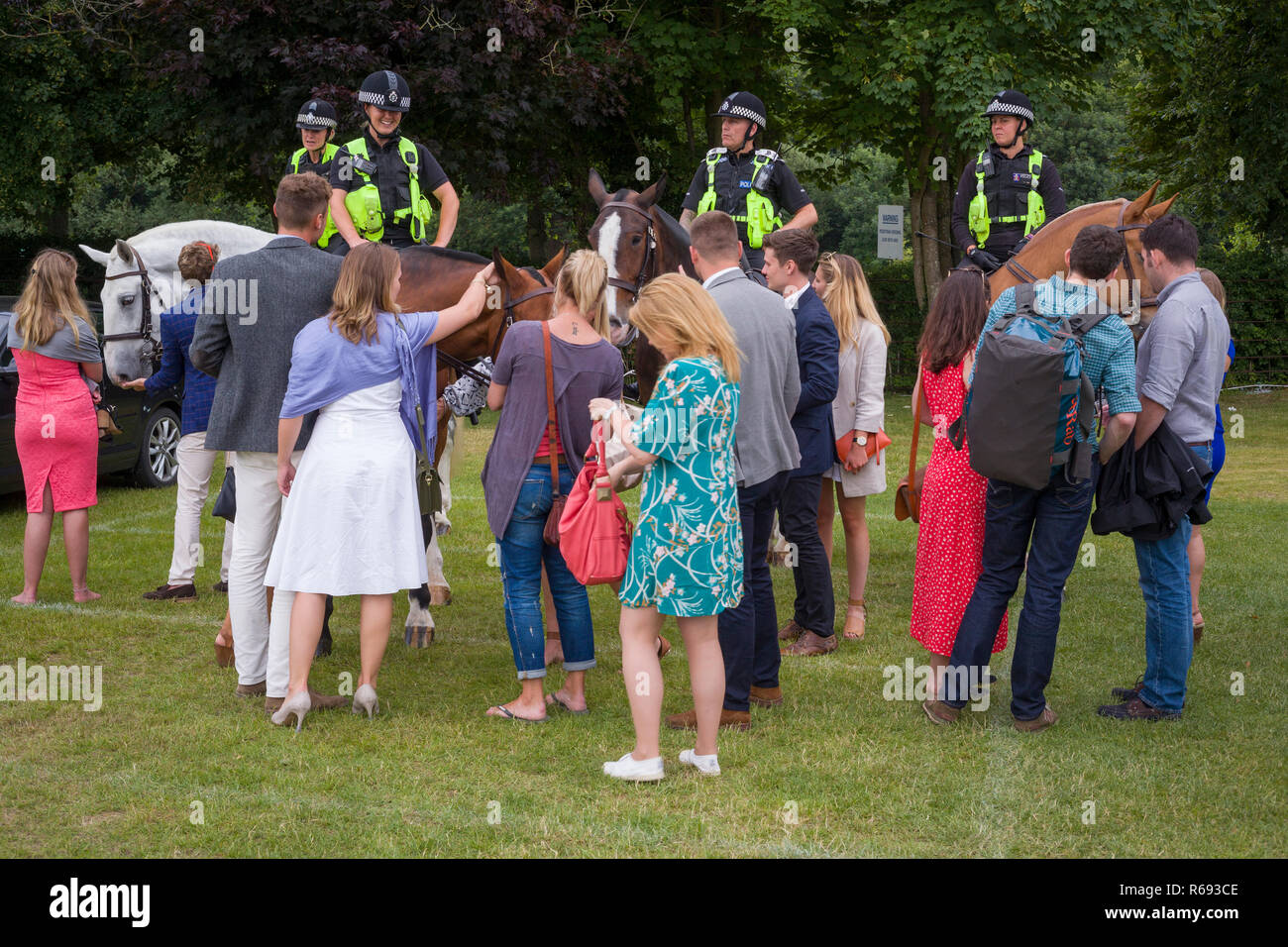 Spectators chat to mounted Thames Valley Police and admire the horses at Henley Royal Regatta - Stock Image