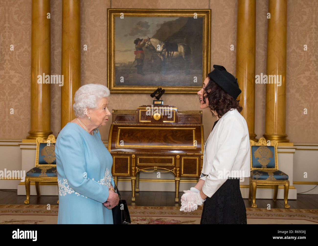 The Ambassador of San Marino Silvia Marchetti presents credentials to Queen Elizabeth II during a private audience at Buckingham Palace, London. - Stock Image