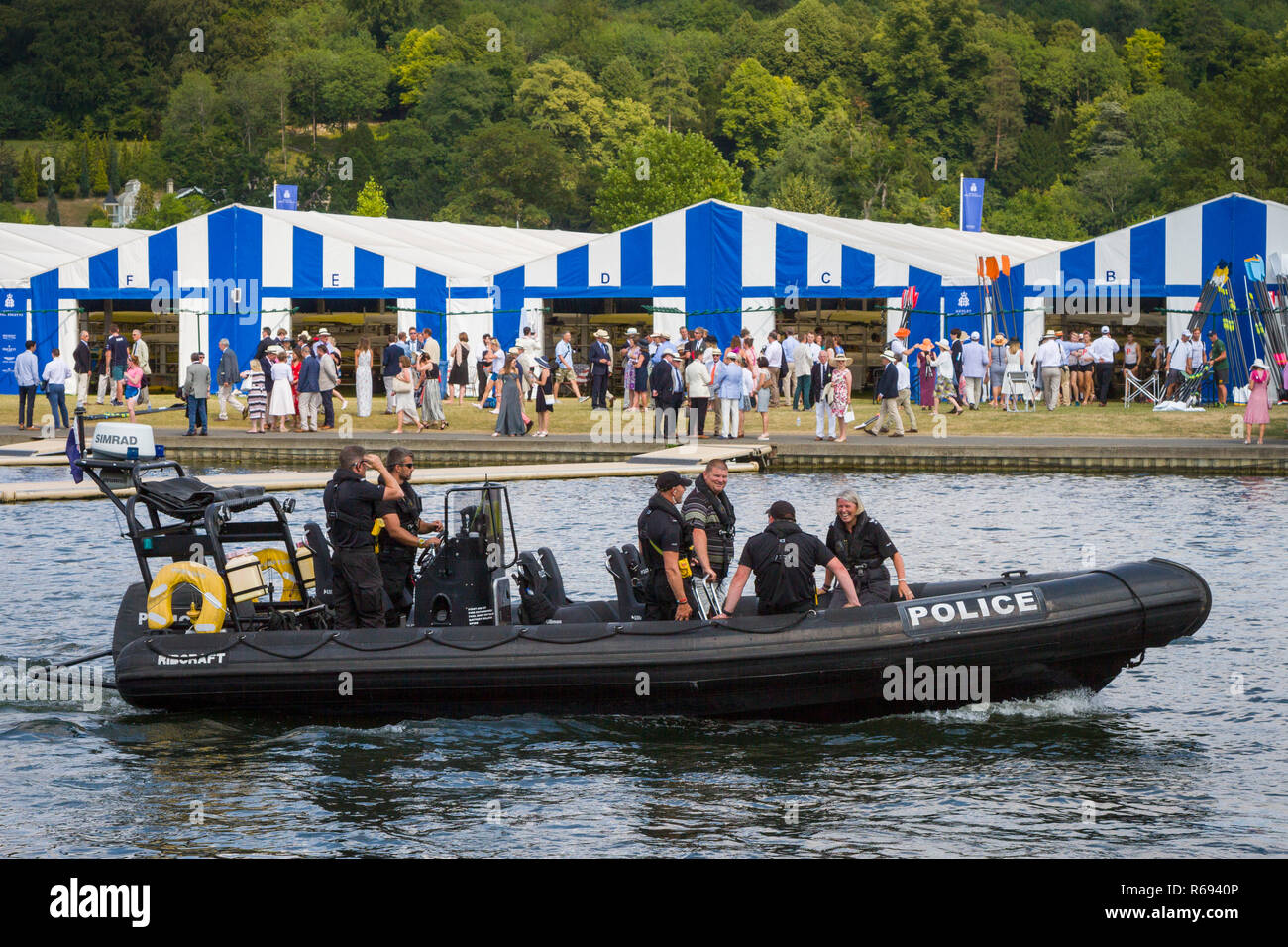 Thames Valley Police patrol the river in their RIB in front of the Boat Tents at Henley Royal Regatta - Stock Image
