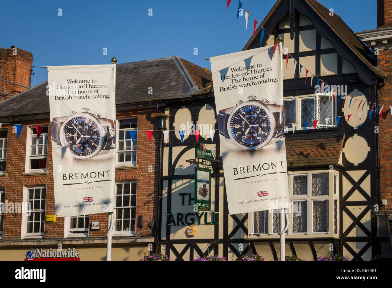 Banners advertising Bremont Chronometers in the centre of Henley during Henley Royal Regatta - Stock Image