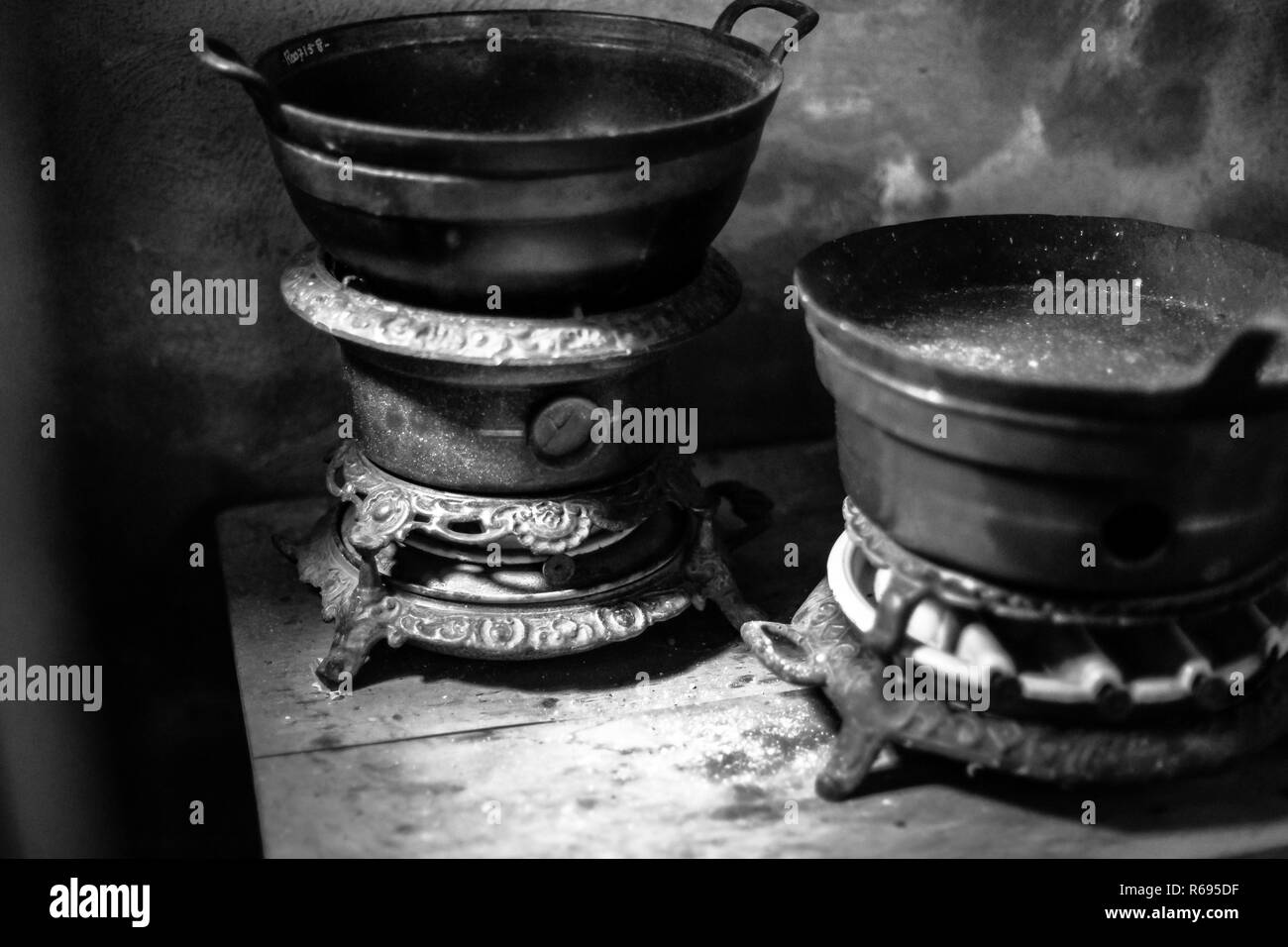 . The authentic kitchen utensils. Vintage kettle and old kerosene stove. - Stock Image