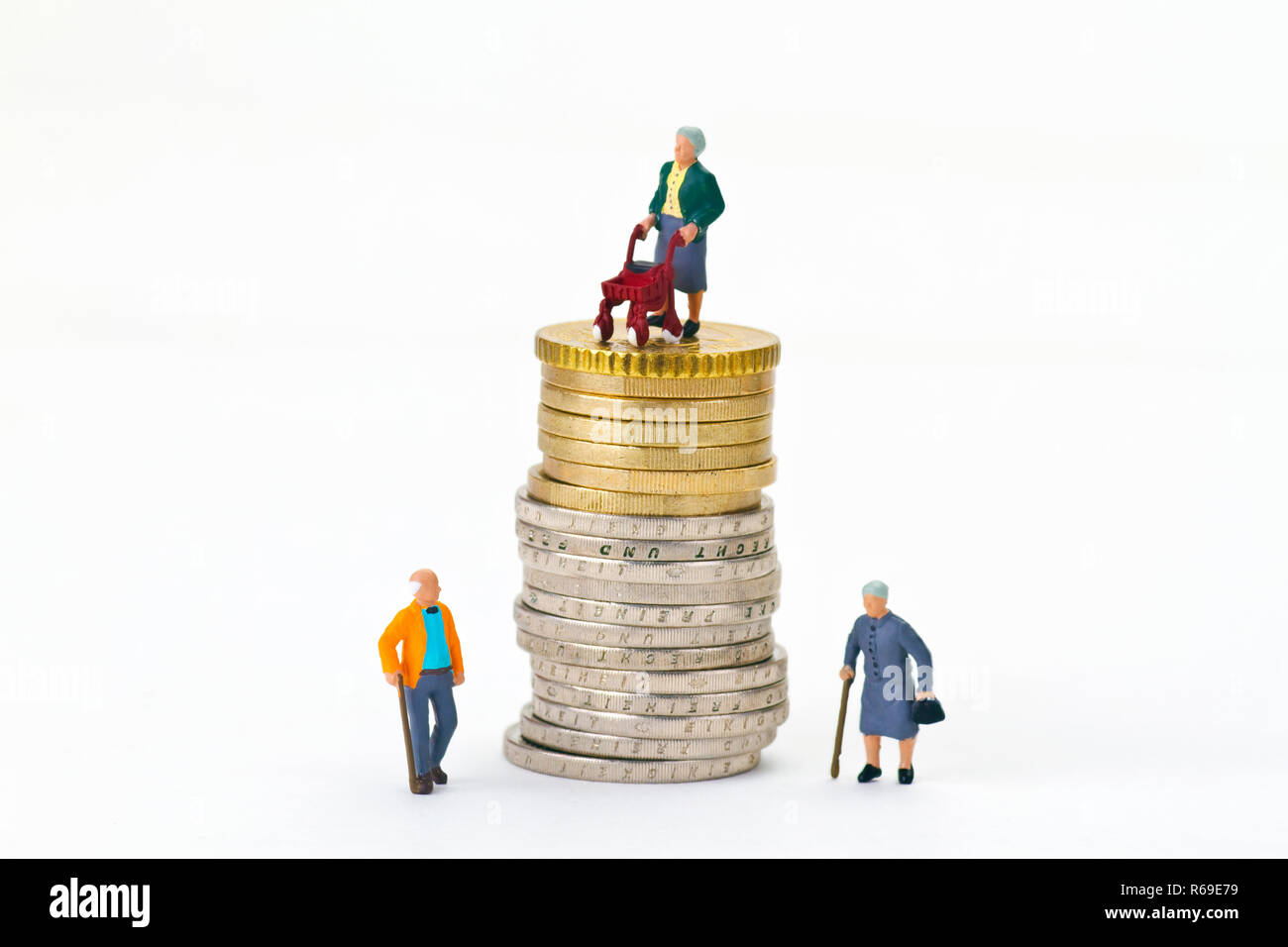 Figures With Euro Coins Stock Photo