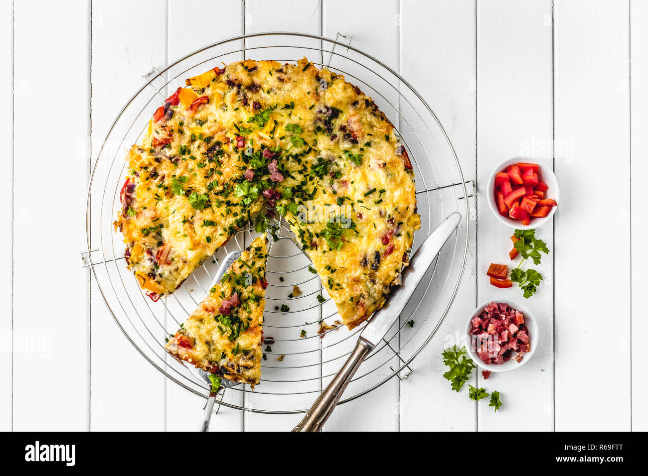 Healthy breakfast food, Stuffed egg omelette with vegetable and bacon - Stock Image