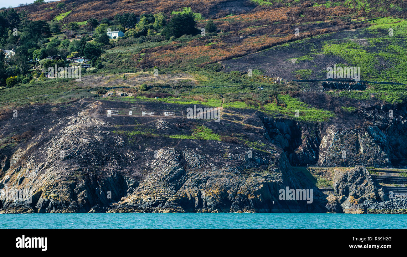 World War Two 'EIRE' sign No 8 at Bray Head, Ireland. View from the sea. - Stock Image