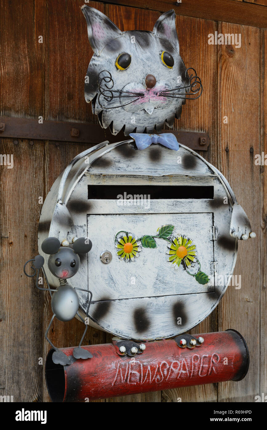 Creative Mailbox In Design Of Cat And Mouse With Newspaper Roll - Stock Image