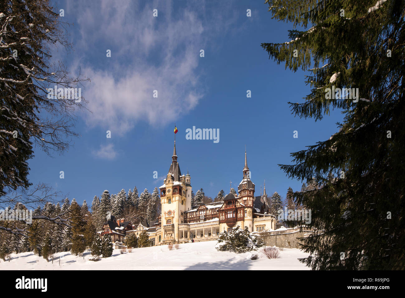 Peles castle in Romania. Beautiful, royal castle in snowy, white winter. Stock Photo