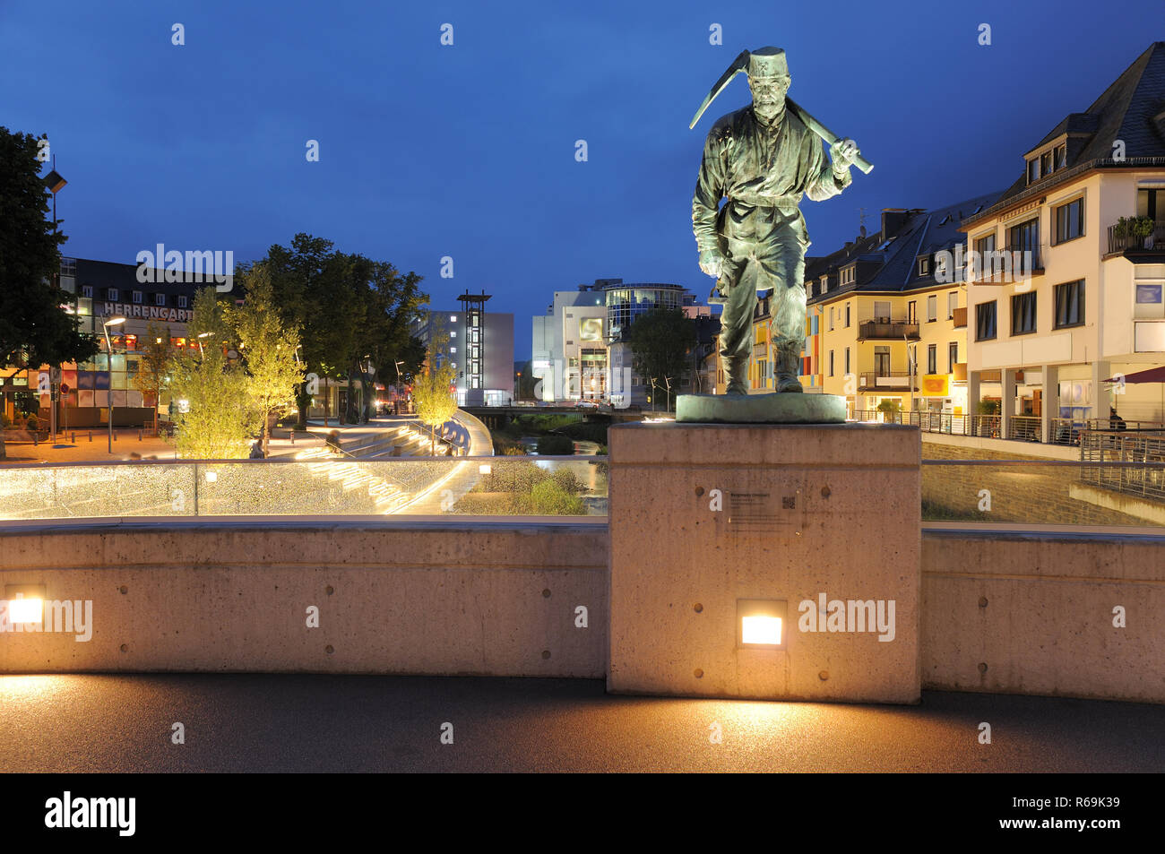 Siegen City Miner Henner At The Sieg Waterside By Twilight - Stock Image