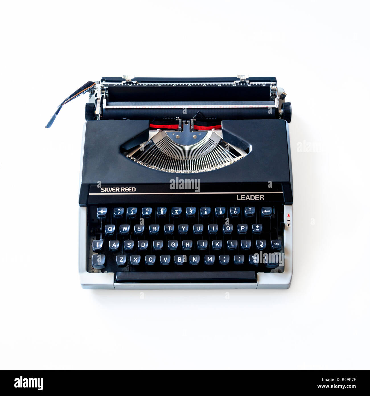 1980 Silver Reed Leader Vintage Manual Typewriter on a white background - Stock Image