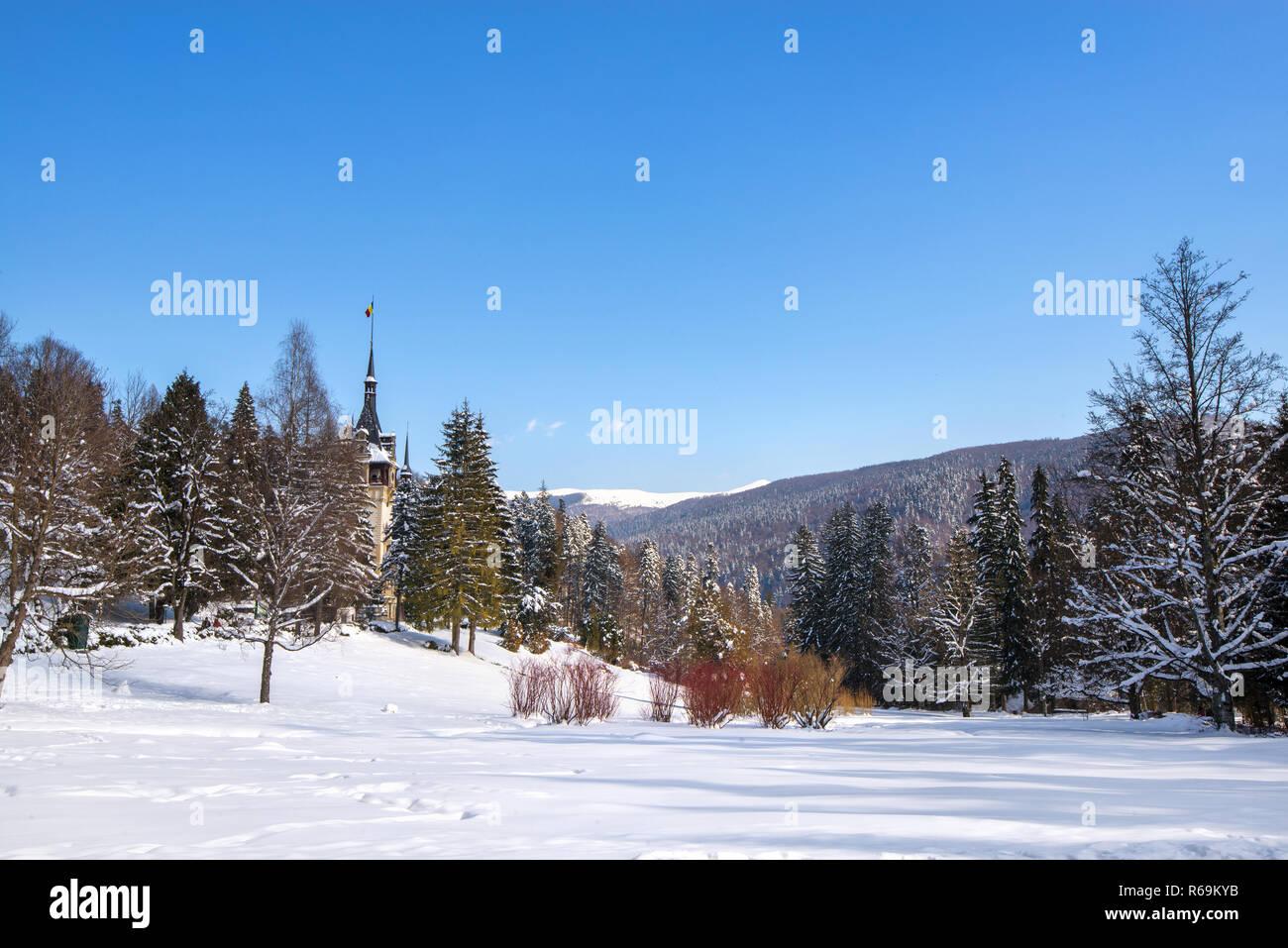 Peles castle in Romania. Beautiful, royal castle in snowy, white winter. - Stock Image