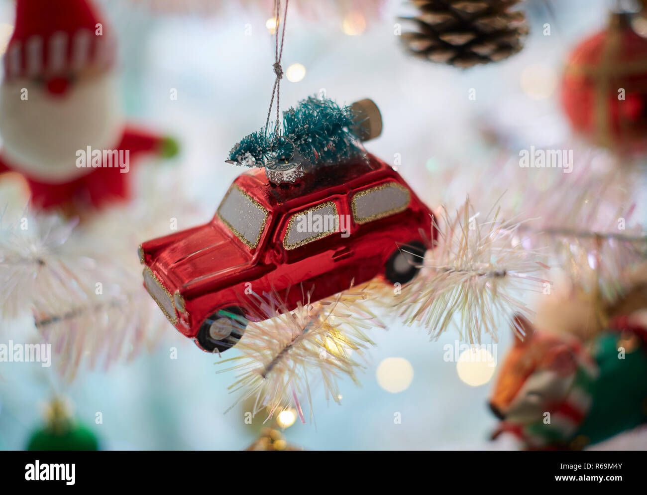 Christmas Car Decorations.Christmas Red Car Decorations With A Tree On Top In A White