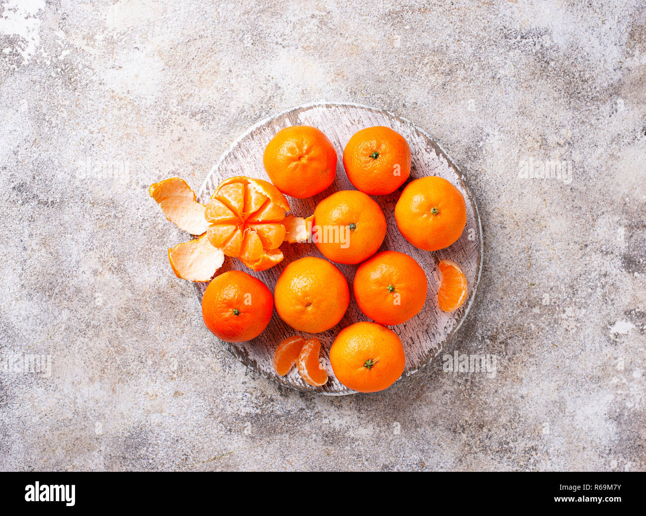Fresh ripe tangerines on light background - Stock Image