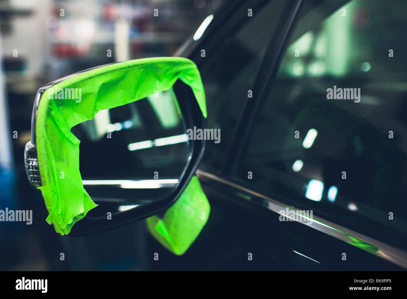 Car detailing - Hands with orbital polisher in auto repair shop - Stock Image