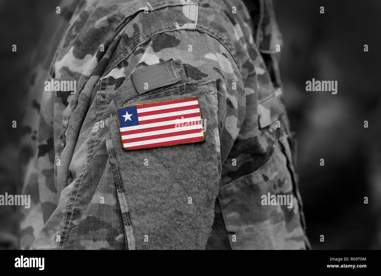 Flag of Liberia on soldiers arm. Liberia flag on military uniform. Army, troops, military, Africa (collage). - Stock Image