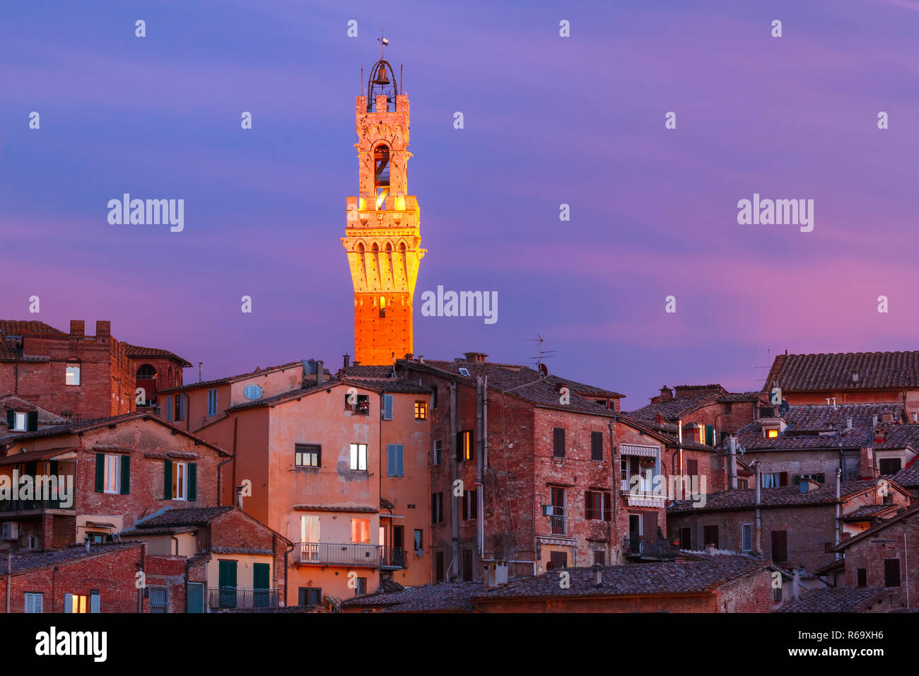 Mangia Tower at gorgeous sunset in Siena, Italy Stock Photo