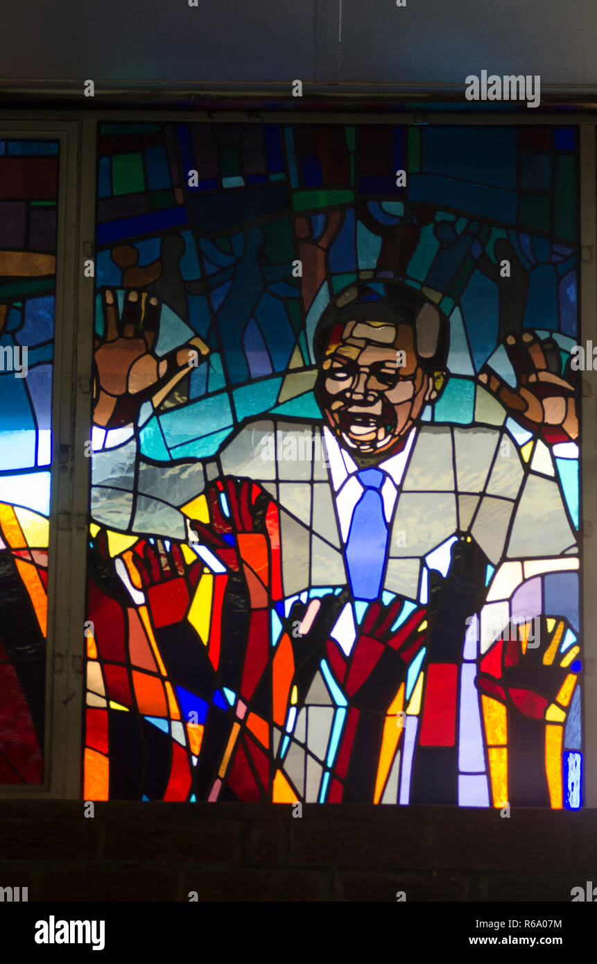 Nelson Mandela is seen depicted as a stained glass window, at a church service for the former South African President at Regina Mundi, Soweto, Sunday, December 8, 2013. The elder statesman died Thursday evening, December 5, 2013. PHOTO: EVA-LOTTA JANSSON Stock Photo