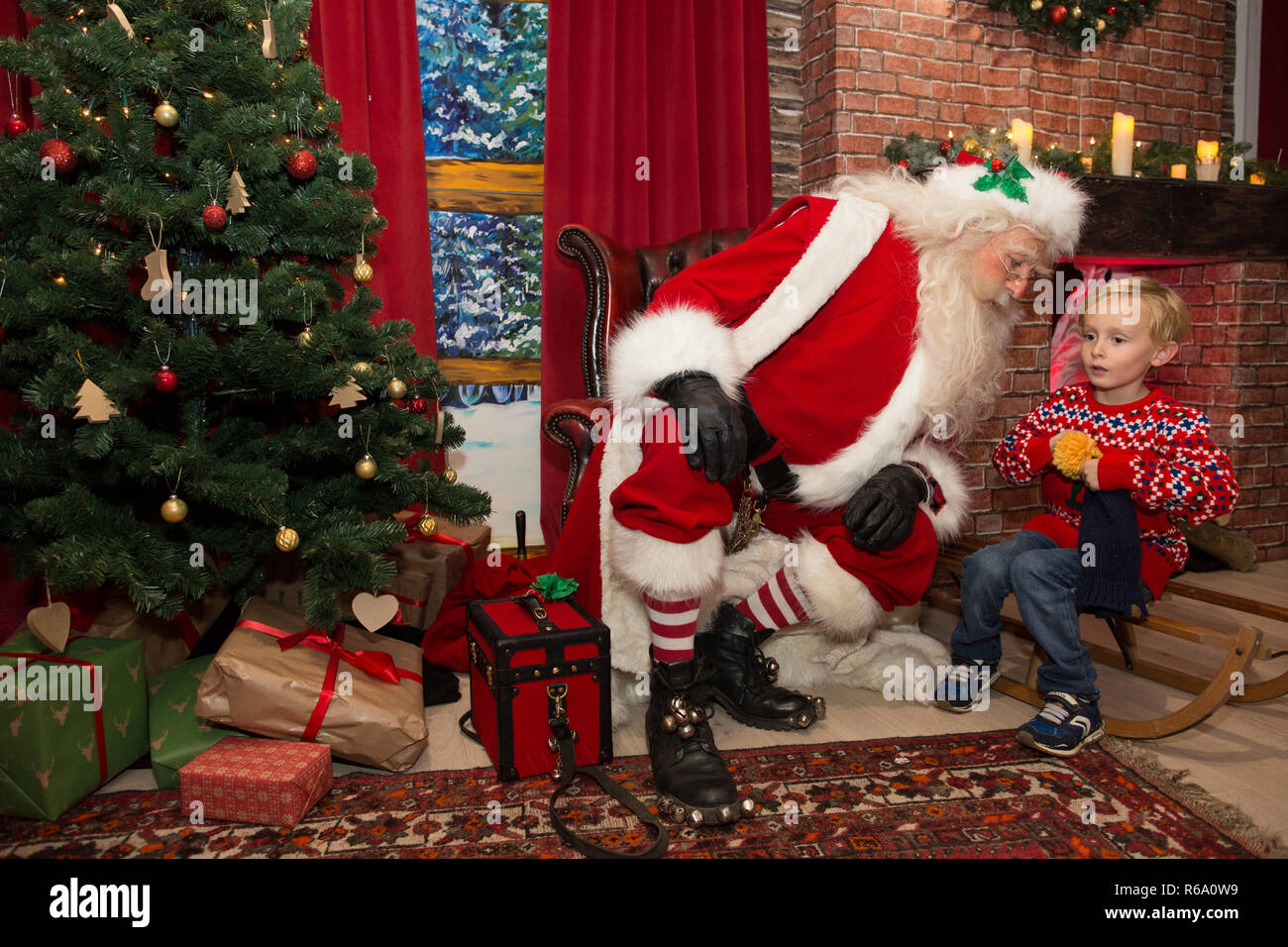 Father Christmas at his Christmas Grotto in southwest London, United Kingdom - Stock Image