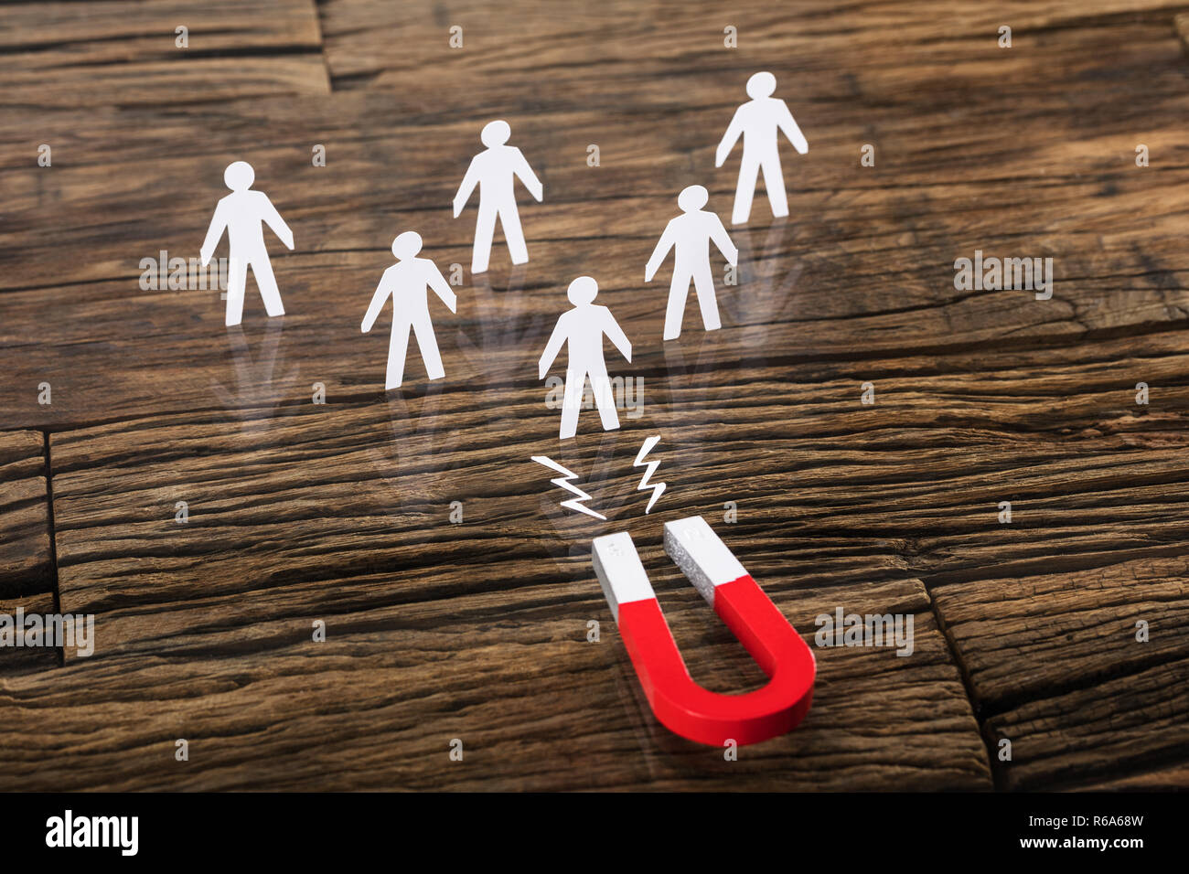 Magnet Attracting Paper Cut Out - Stock Image