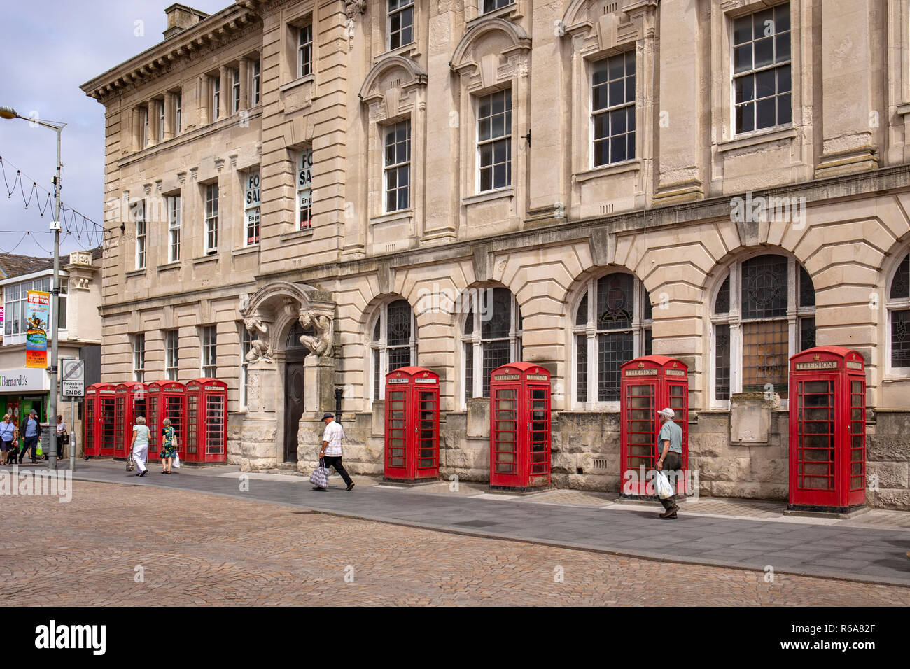 8 K2 telephone boxes outside the former police head quarters and General Post Office and Sorting office building in Abingdon Street Blackpool UK - Stock Image