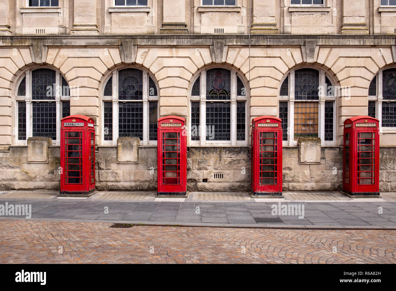 4 of 8 K2 telephone boxes outside the former police head quarters and General Post Office and Sorting office building in Abingdon Street Blackpool UK - Stock Image