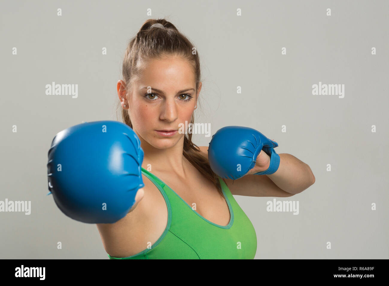 Young Woman With Boxing Gloves Showing Ready To Fight - Stock Image