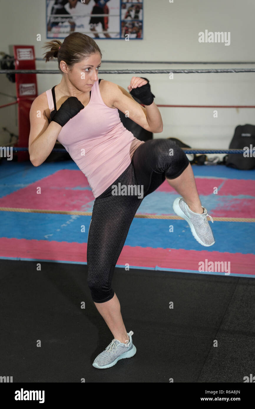 Woman Practices Her Speed In The Range Kickboxing - Stock Image