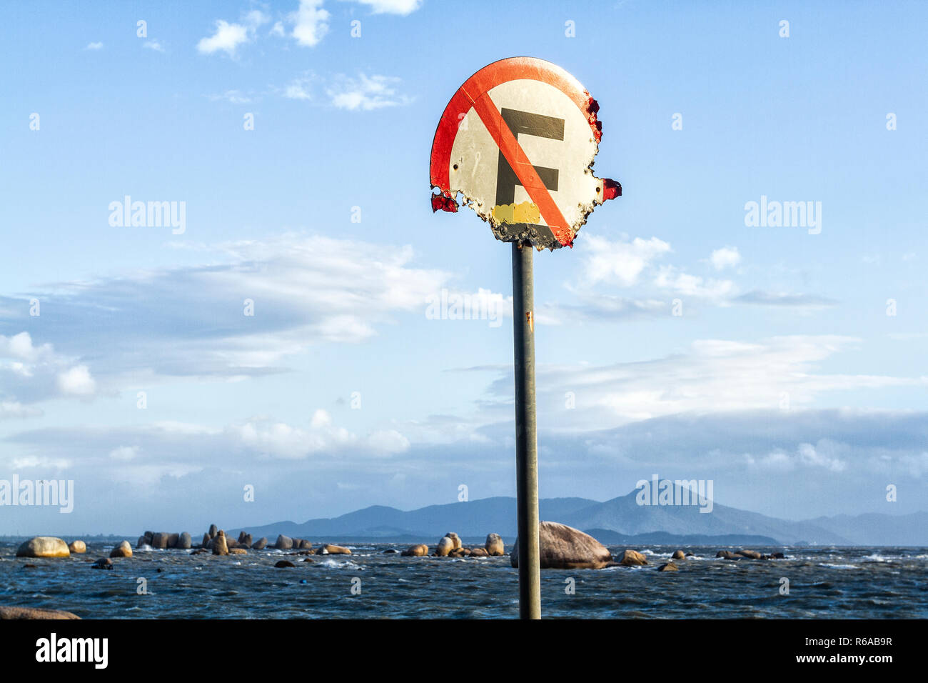 No parking sign corroded by sea air. Florianopolis, Santa Catarina, Brazil. - Stock Image
