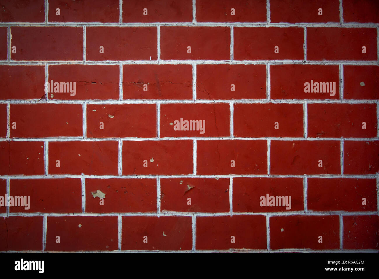 Red Paint Wall Red bricks wall with cracked red paint texture. Red vrick background for  design and text