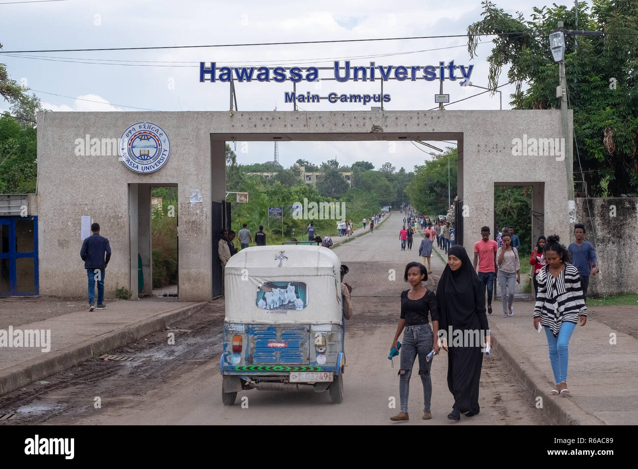 15 November 2018: Students walk out the entrance to Hawassa