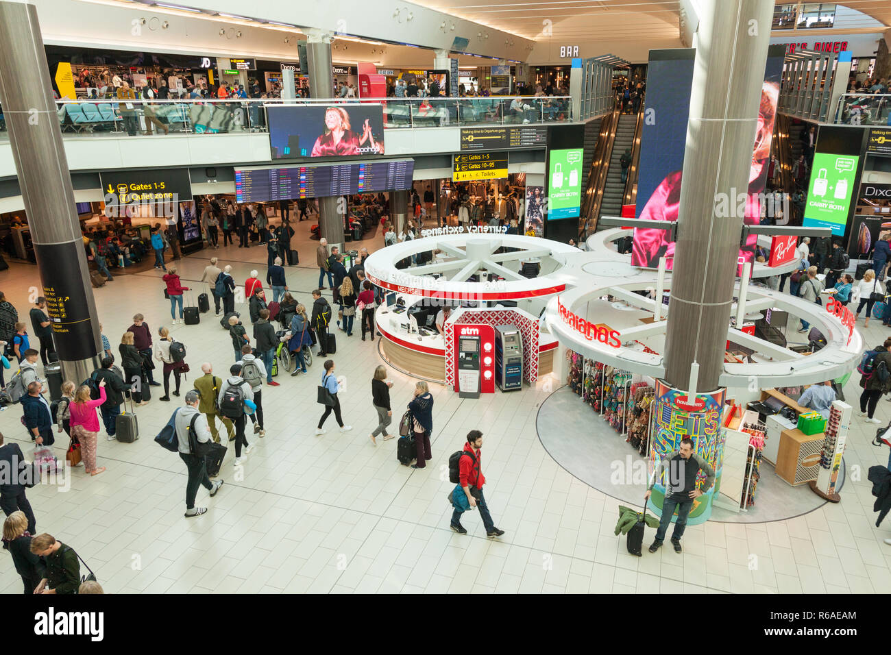 Shops and restaurants in departure lounge of London Gatwick Airport  LGW South terminal, England, United Kingdom. - Stock Image