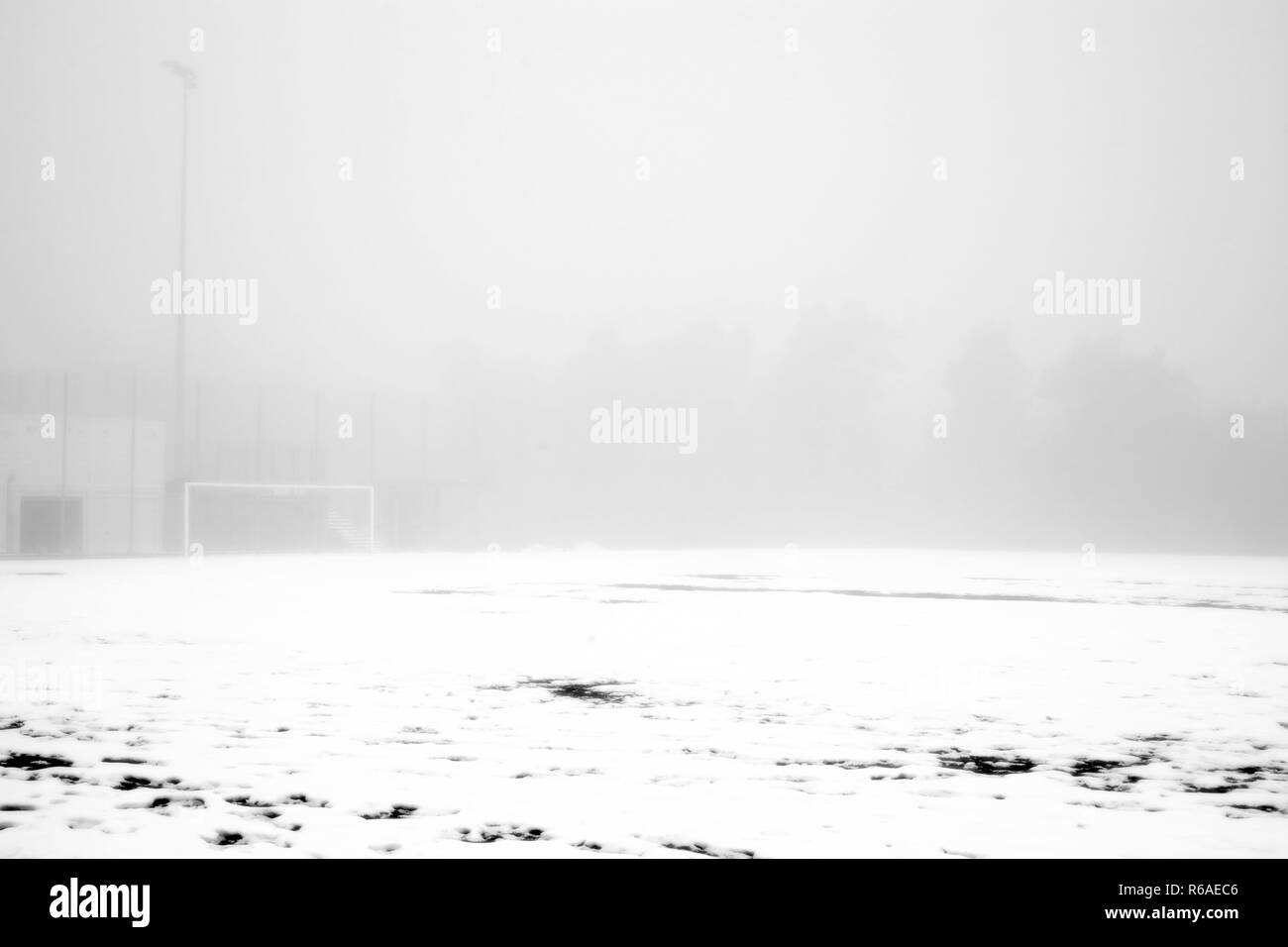 Soccer Field In The Snow And Fog - Stock Image