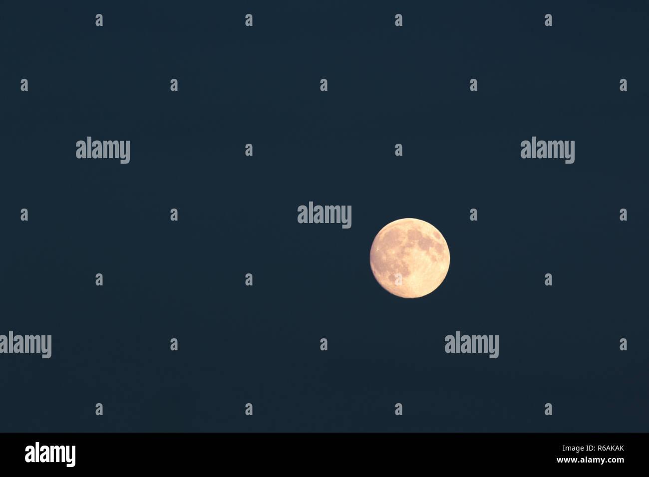 Full Moon Over Dark Blue Night Sky - Stock Image