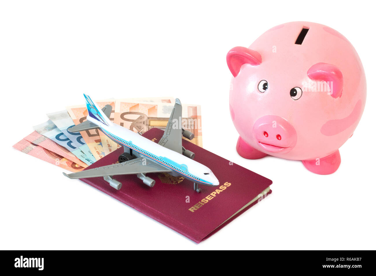Passport With Toy Plane And Piggy Bank - Stock Image