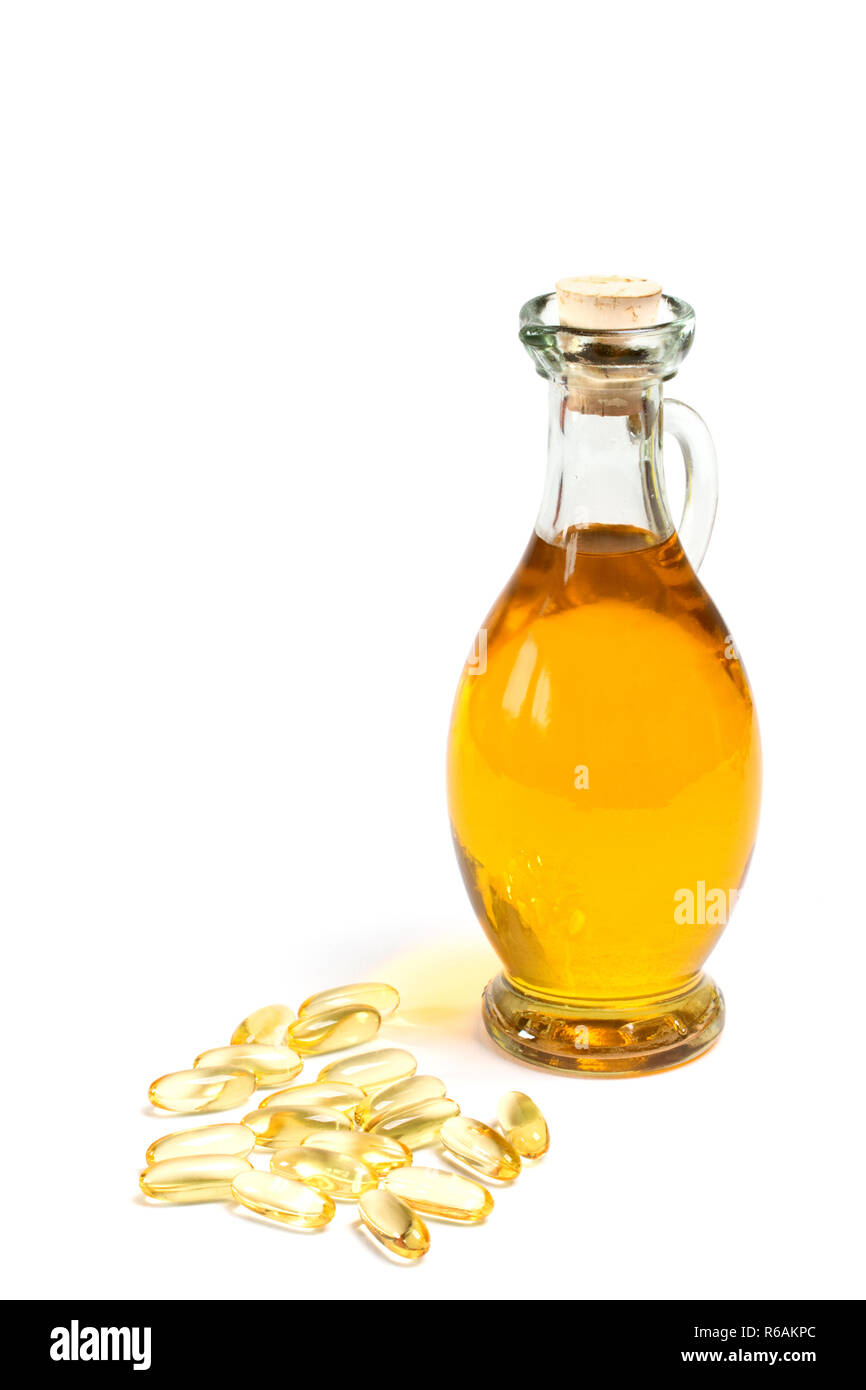 Glass Bottle Of Oil With Vitamin Capsules Stock Photo