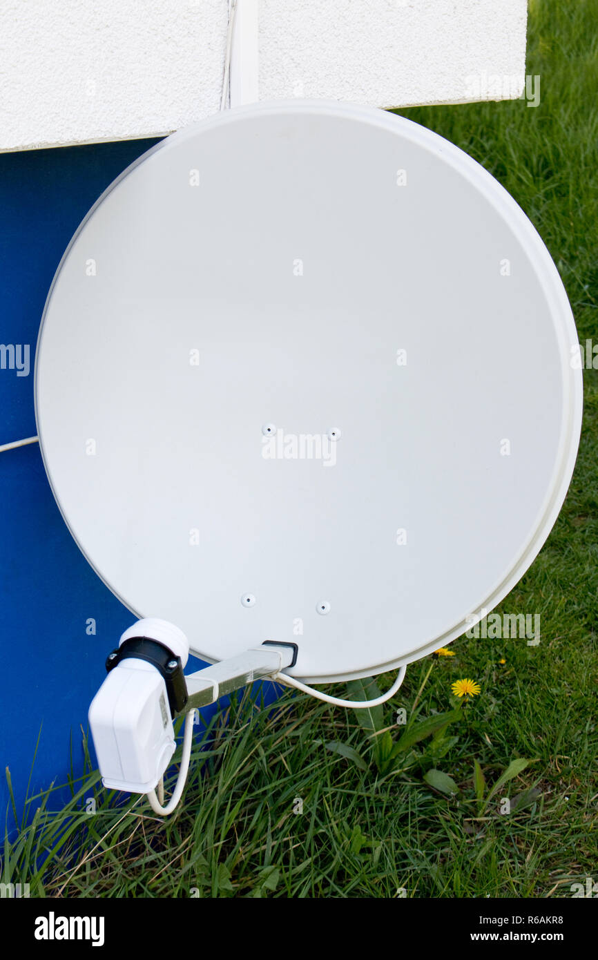 Satellite Dish On A Outer Wall - Stock Image