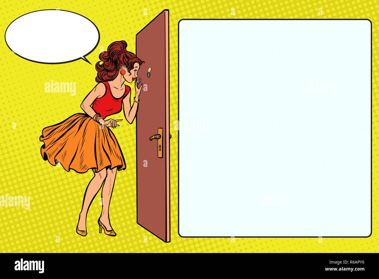 woman peeking through the peephole Stock Photo