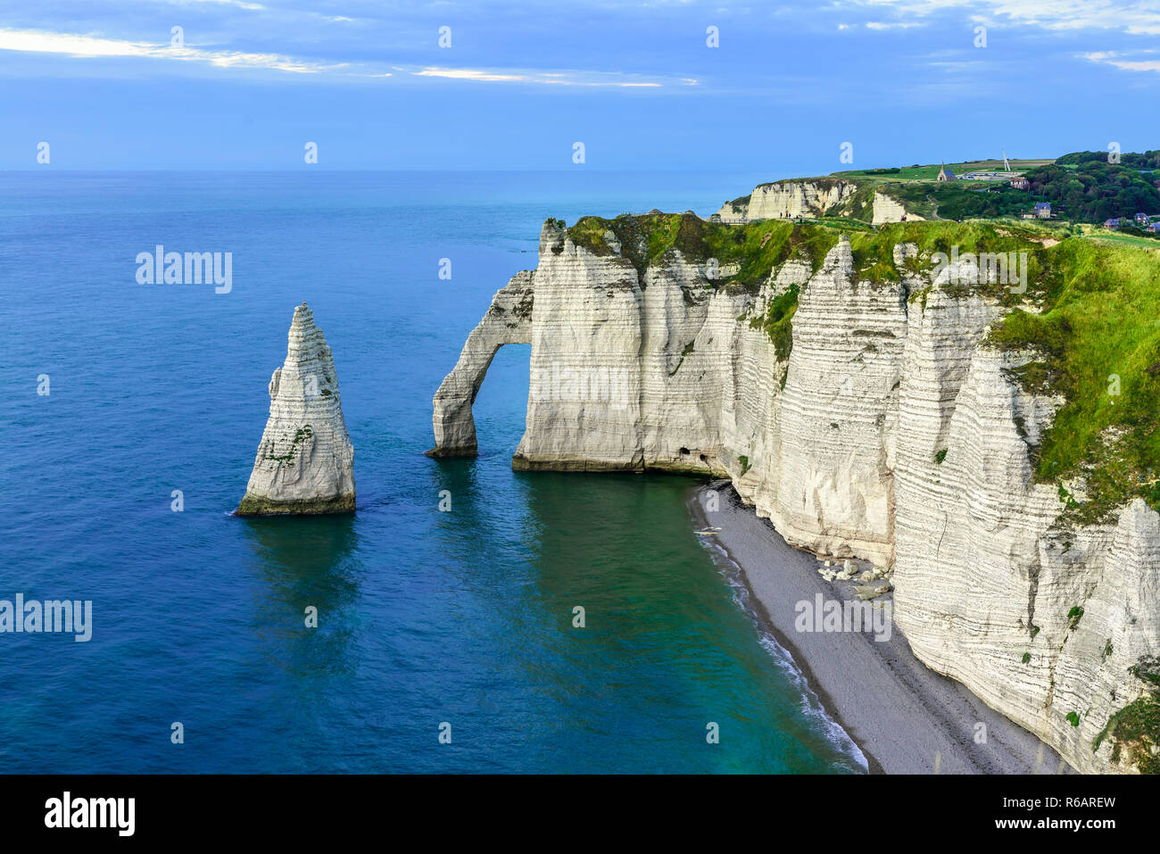 Etretat, Normandy, France. cliffs Aval and Needle with beautiful famous coastline during the tide at sunset - Stock Image