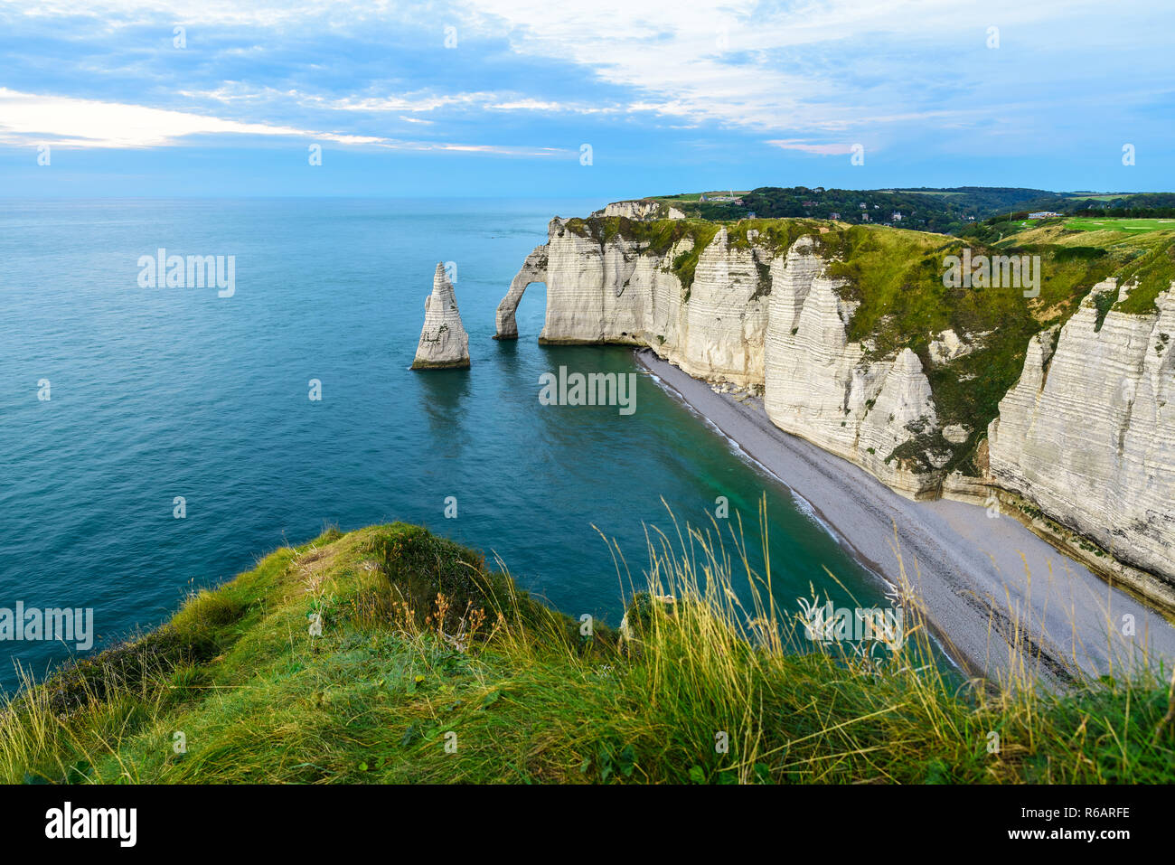 cliffs Aval and Needle of Etretat and beautiful famous coastline during the tide. Normandy, France, Europe - Stock Image