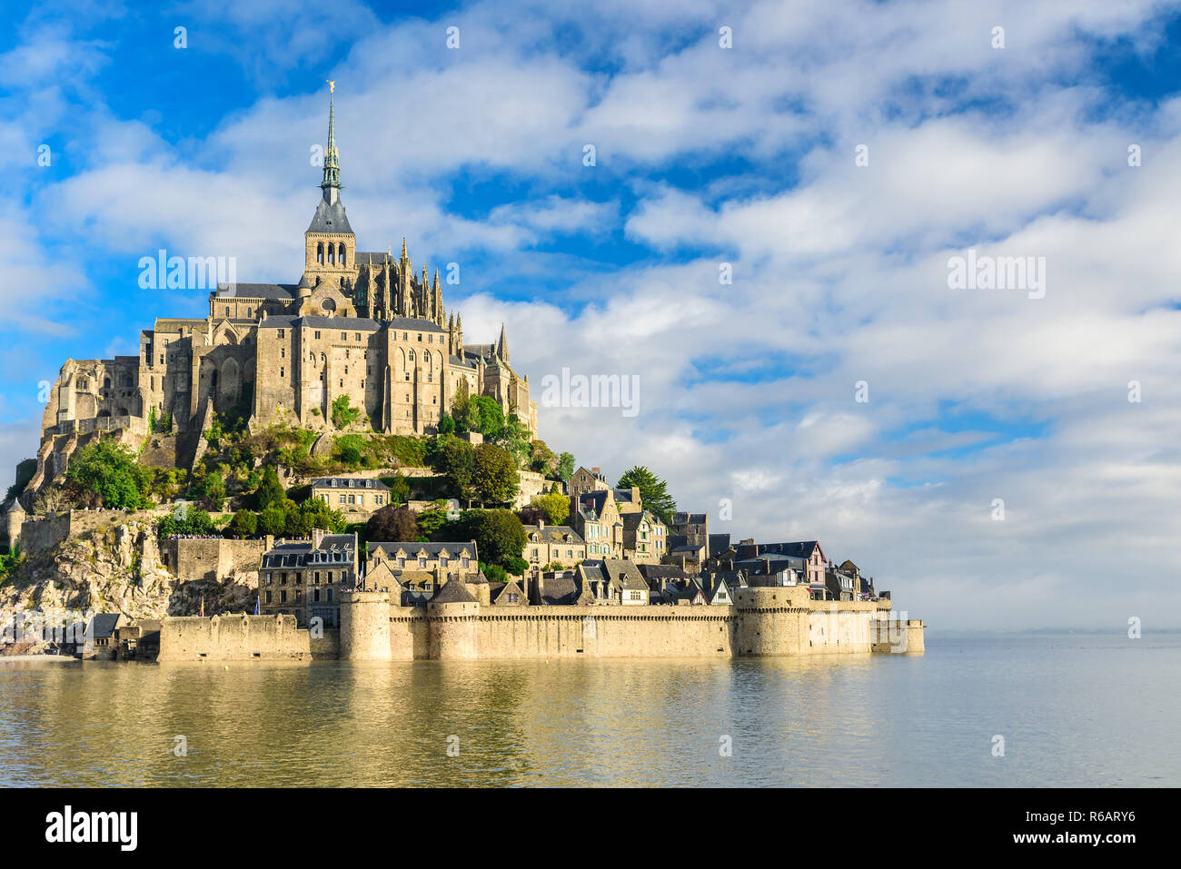 Mont Saint Michel abbey on the island, Normandy, Northern France, Europe at sunrise - Stock Image