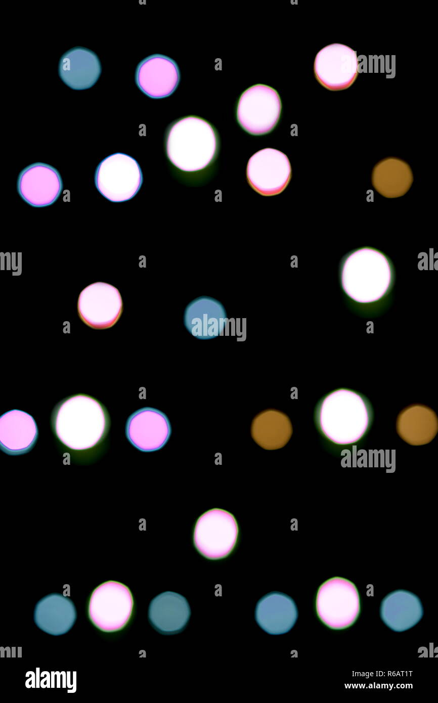 Colorful defocusing shiny glowing lights - Stock Image