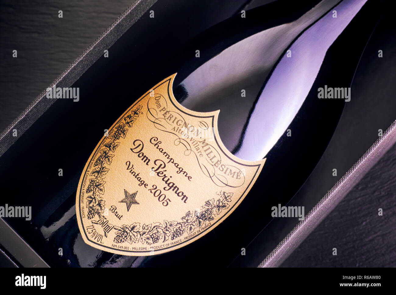 Tambov, Russian Federation - August 14, 2018 Close-up of Bottle of Champagne Dom Perignon Vintage 2005 in box. Black background. Studio shot. - Stock Image