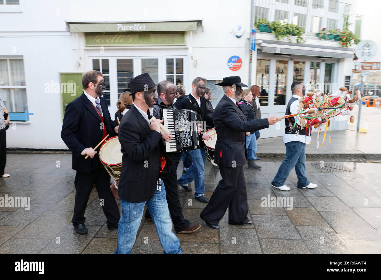 Mummers Day sometimes known as Darkie Day, ancient traditional parade with music and dancing through the streets of the town.Padstow,Cornwall, UK. - Stock Image