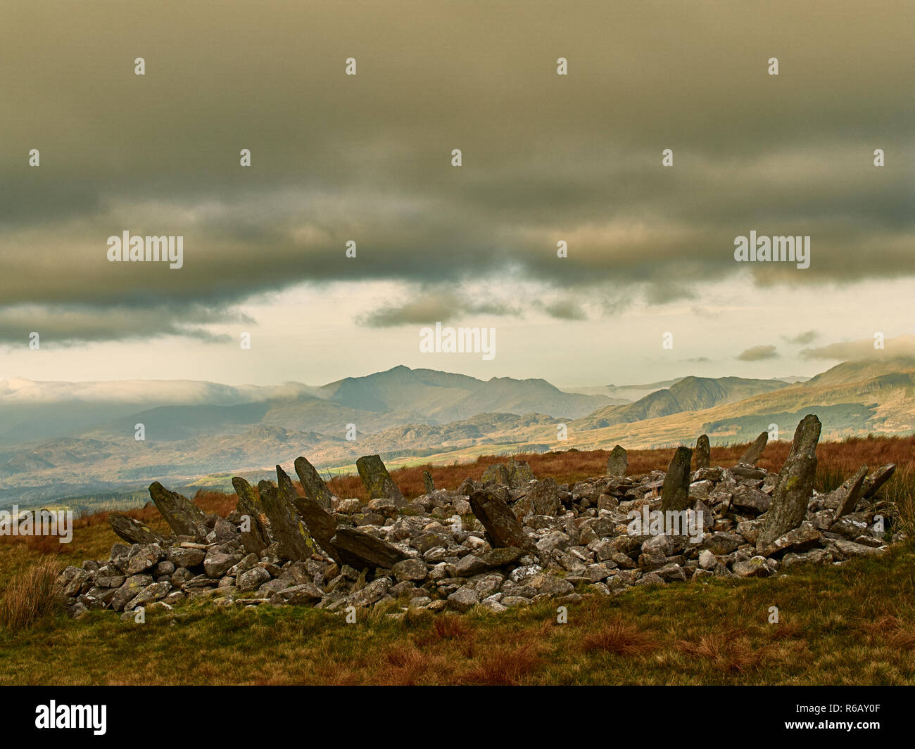 Bryn Cader Faner Cairn Circle. A combination of burial mound with a stone circle of slabs. Set in a scenic landscape with mount Snowdon to the north. Stock Photo