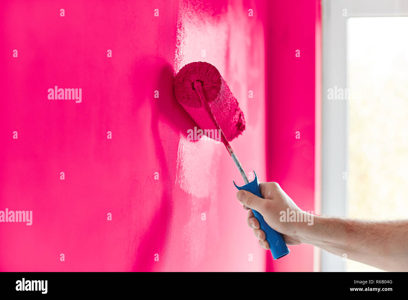 Male Hand Painting Wall With Paint Roller Painting Apartment