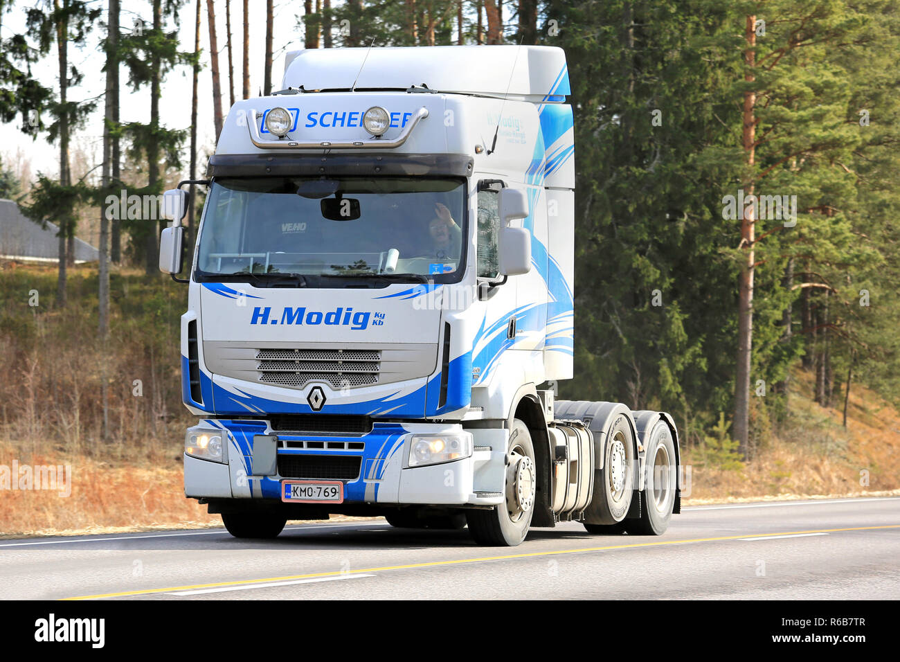 Salo, Finland - March 26, 2017: Blue and white Renault Premium truck of Helmer Modig Oy trucking along highway 52 on a sunny day of early spring. - Stock Image