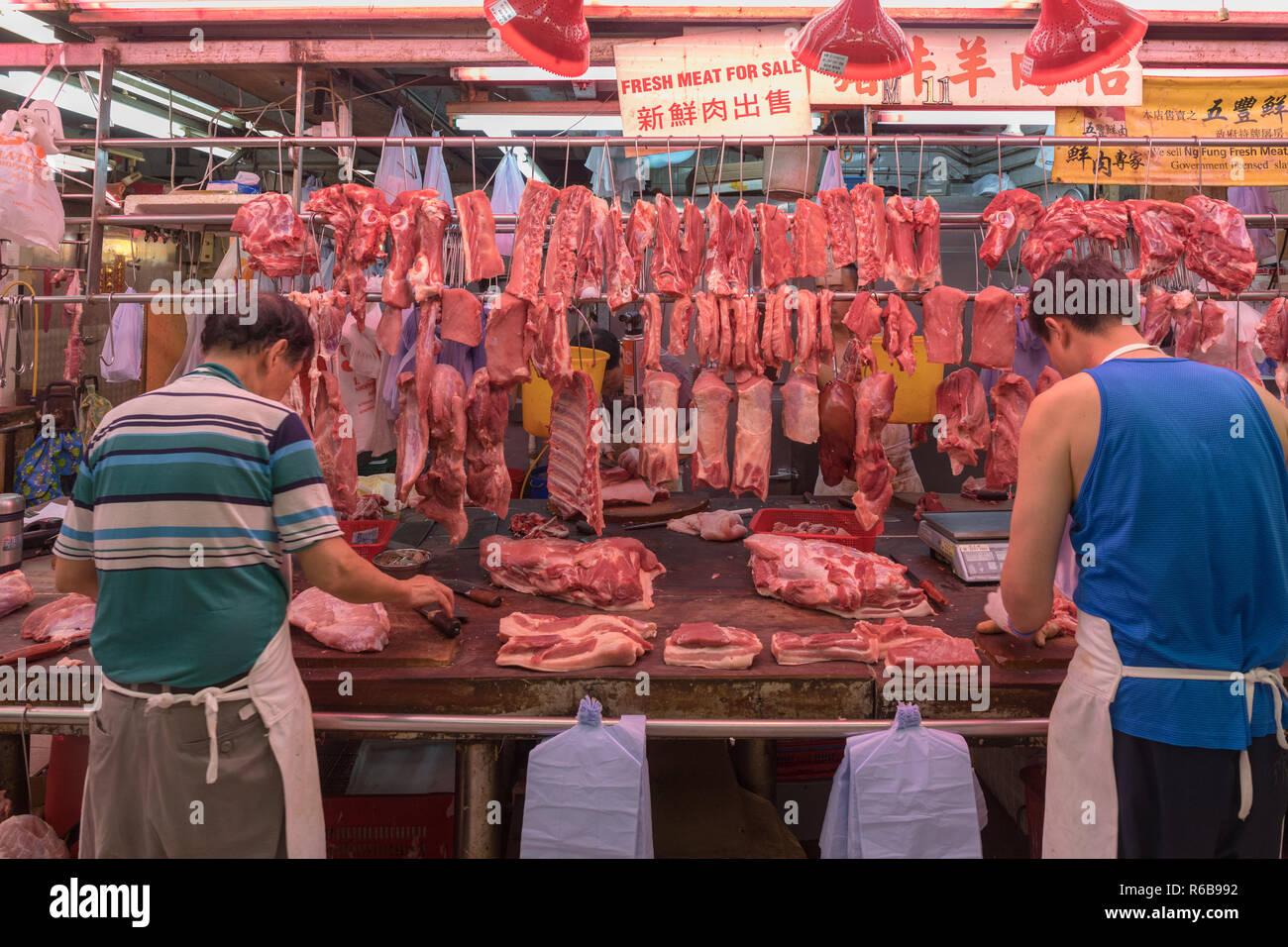 KOWLOON, HONG KONG - APRIL 21, 2017: Butcher Stall at Fa Yuen Street Market in Kowloon, Hong Kong. - Stock Image