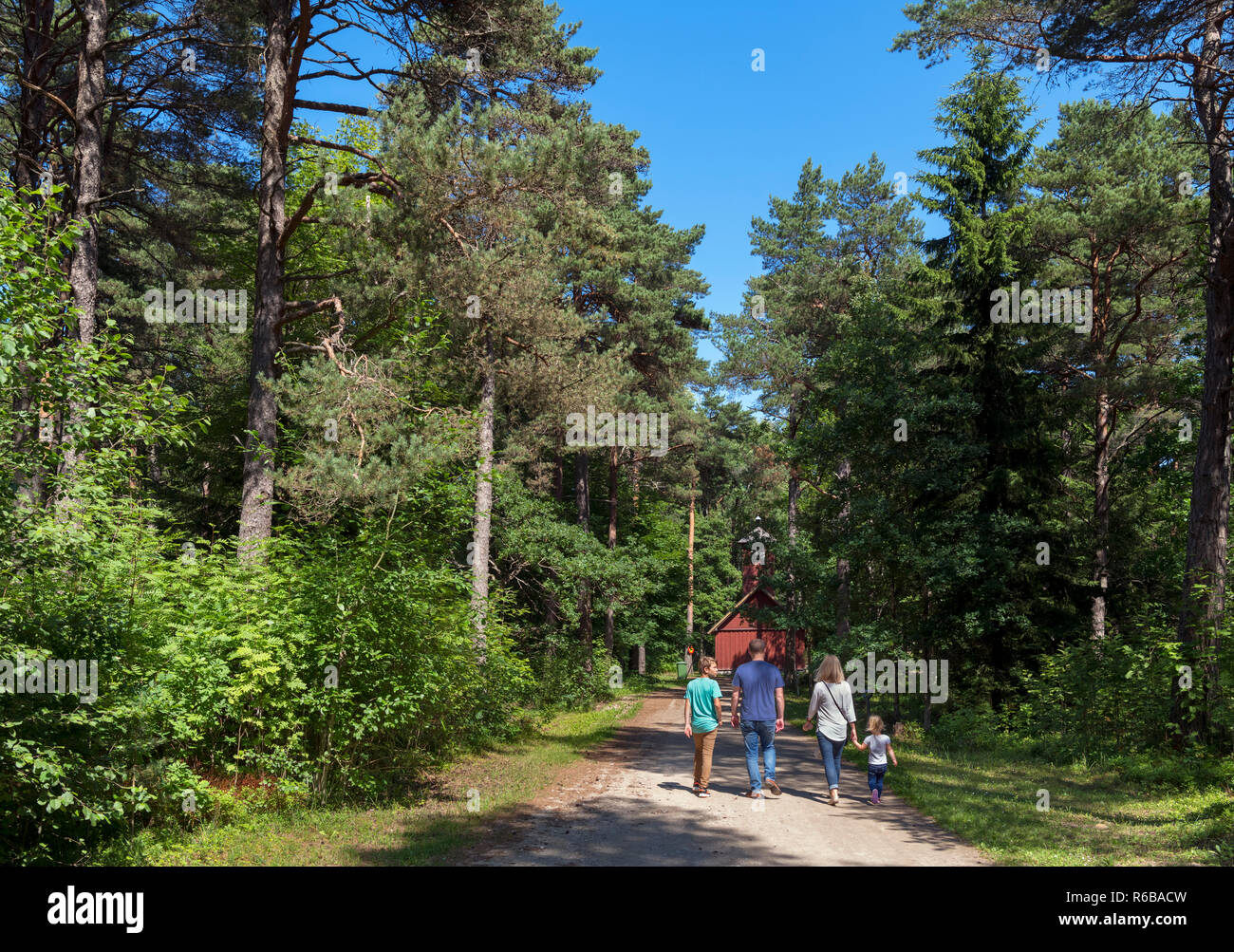 Family walking through the Estonian Open Air Museum near the Fire Station,Tallinn, Estonia - Stock Image