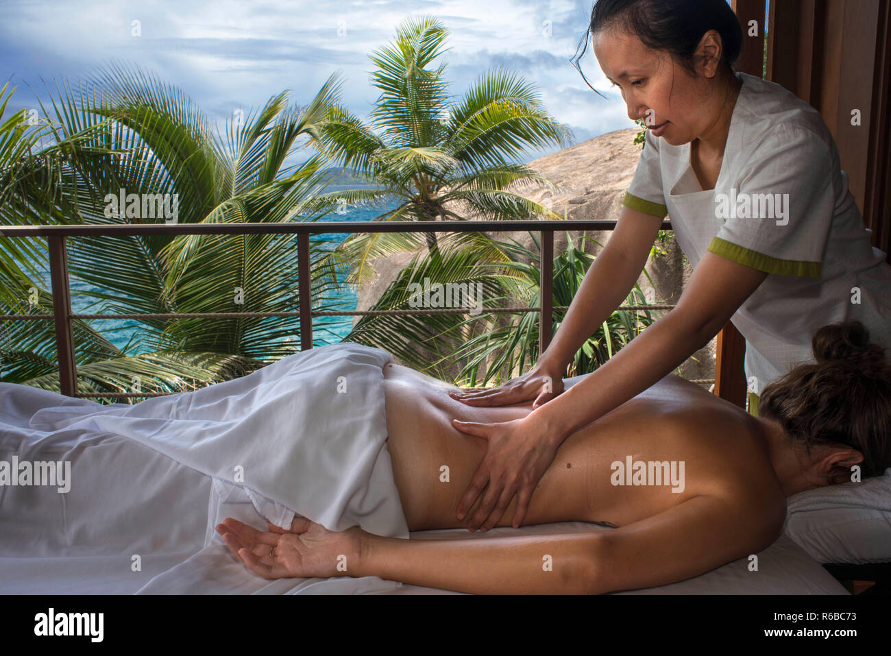 Relaxing massage in Six Senses Zil Pasyon luxury hotel. Felicite island Seychelles. - Stock Image