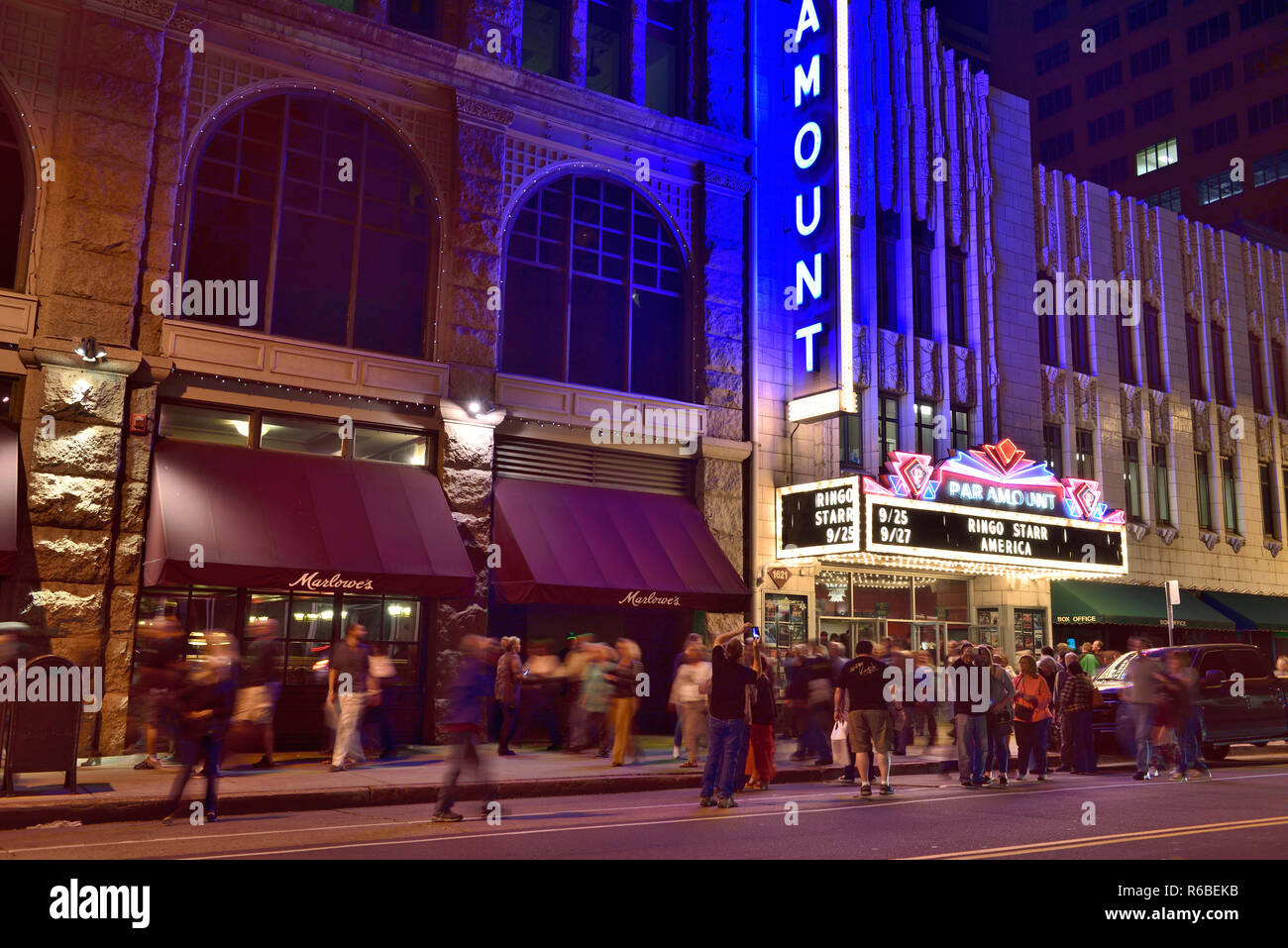 Crowds on street outside Paramount Theatre, Denver, Colorado, after Ringo Starr American tour performance - Stock Image